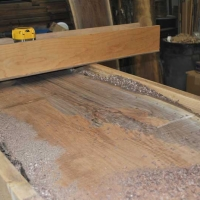 Walnut Slab Table surfacing the slabs with router